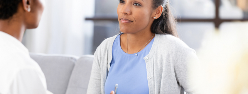 Woman talking to doctor about breast vein treatment