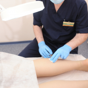 Doctor performing sclerotherapy